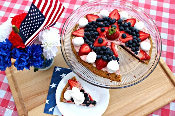 Grilled Dessert Cookie Pizza on Serving Platter with Strawberries, Blueberries, Marshmallows, and Sweet Cream Cheese