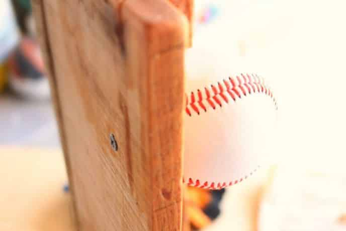 Attaching baseballs to baseball hat rack