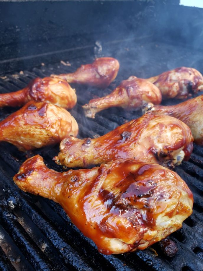 grilling chicken drumsticks on the barbecue grill