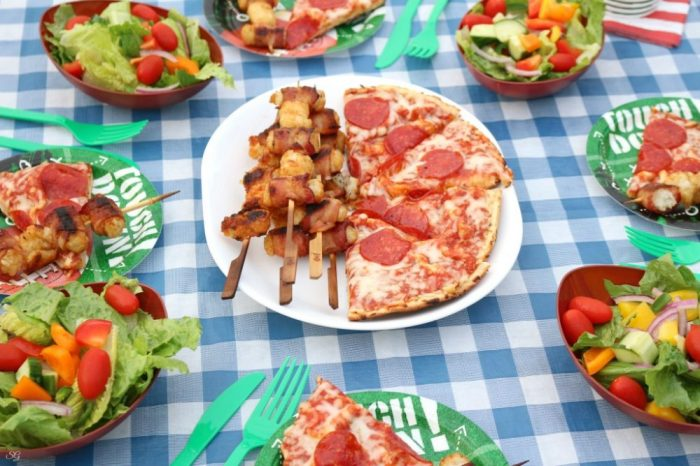 Grilled meal with pizza, salad and more