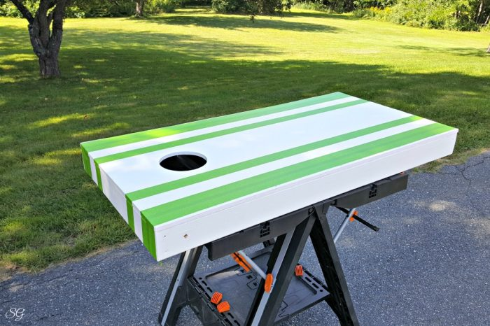 Taping off paint lines for homemade cornhole boards