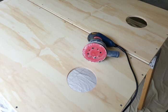Sanding plywood before painting