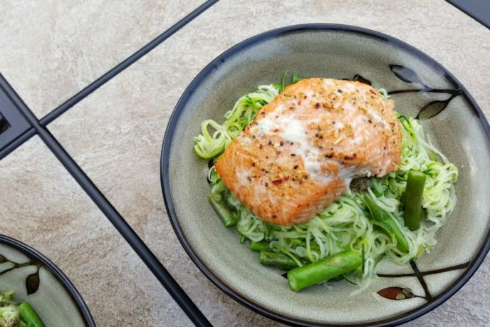Cedar plank salmon over pesto zoodles