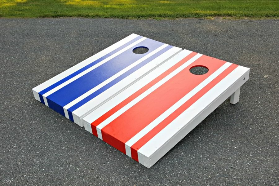 Red and Blue stripes on DIY cornhole board set. How to build cornhole boards DIY painted with red, white, and blue paint!