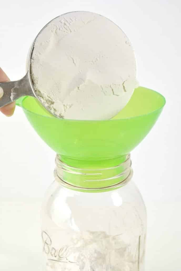 Adding flour to mason jar for cookies