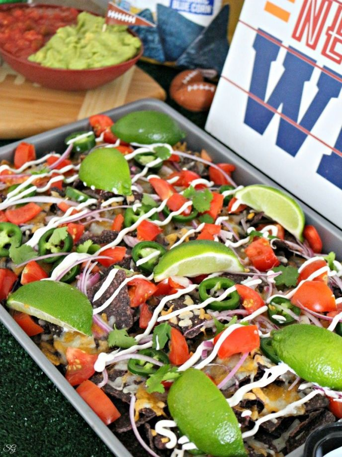 Sheet Pan Nachos Recipe for Football Parties! Cheer on your favorite team with these sheet pan nachos made with Garden of Eatin Blue Corn Tortilla Chips! #football #party #partyfood #recipe #delish #yummy #eat #foodie #foods #nacho #baking #bake #easyrecipe #recipes