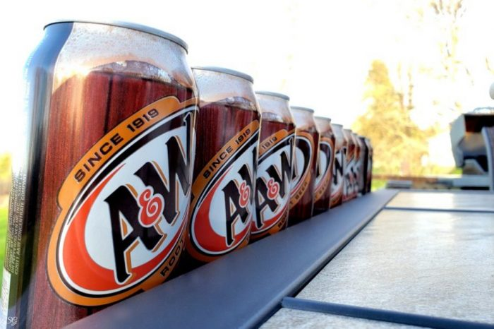 Cans of A&W Root Beer lined up on table