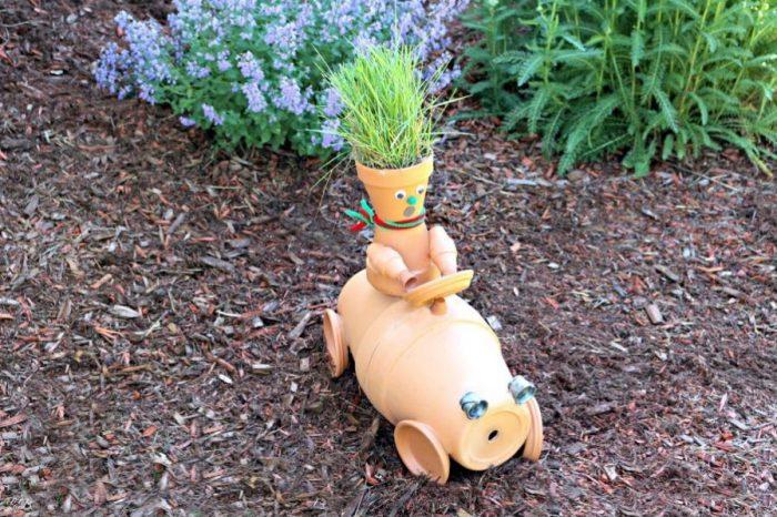 Terra cotta pot garden sculpture race car