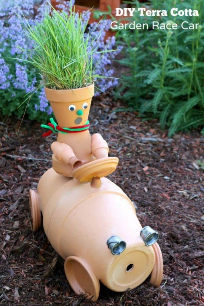 DIY clay terra cotta pot garden race car man sculpture. #diy #garden