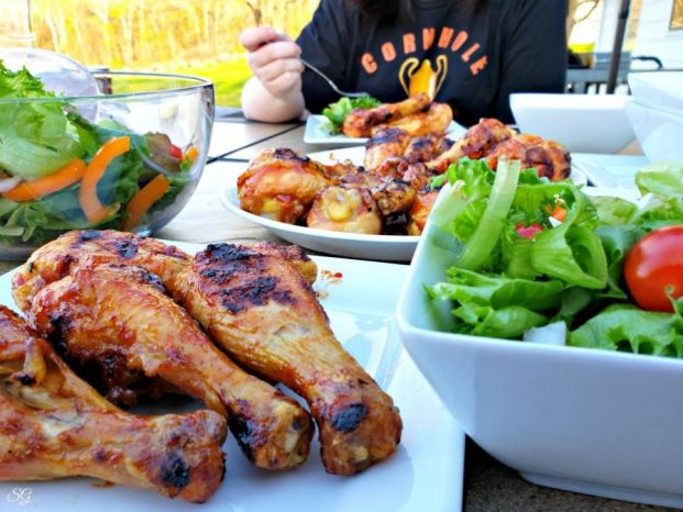 Root beer BBQ sauce on chicken served with salad