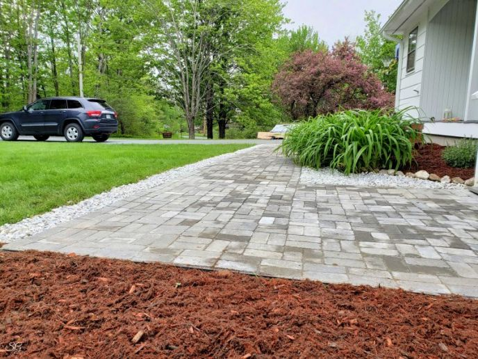 DIY Paver Walkway Installation with Marble and Mulch Borders