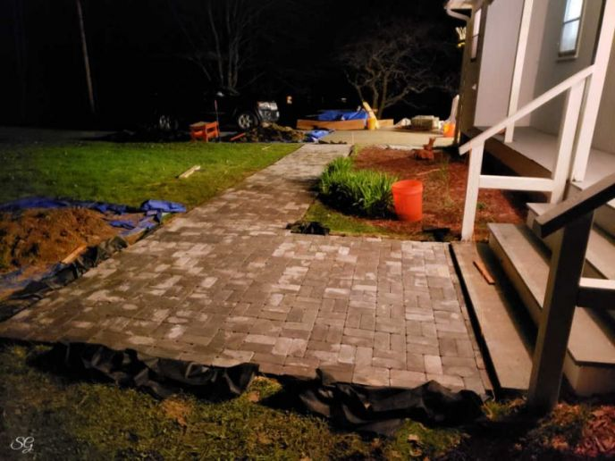 Pavers are install on DIY paver walkway