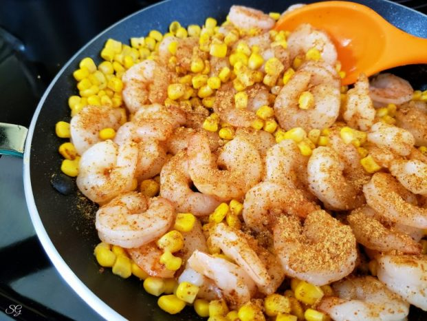 Shrimp and corn tostadas, cooking shrimp and corn in a skillet