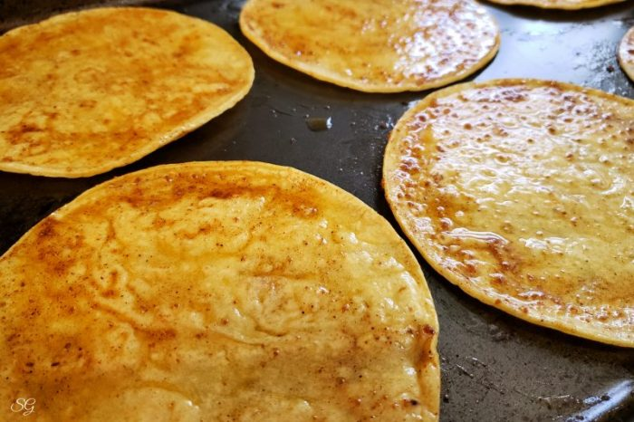 Corn tortillas brushed with oil to make crunchy baked tostadas
