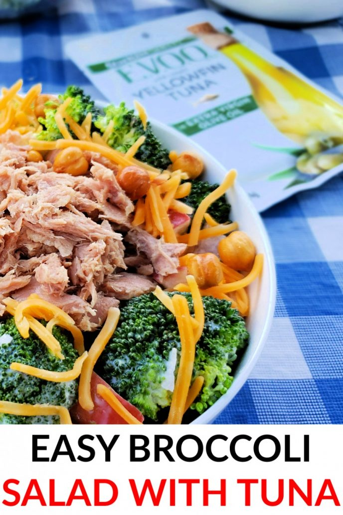 Tuna fish broccoli salad in a bowl with cheese and garbanzo beans.
