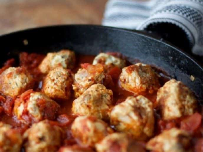 turkey bacon meatballs in a cast iron skillet