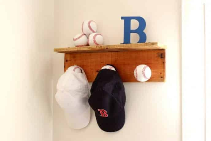 Baseball hat rack to display baseball caps.
