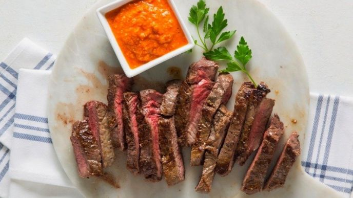 How to cook sirloin steak; stove top, in a pen, in the oven, the steak is sliced and plated with romesco sauce