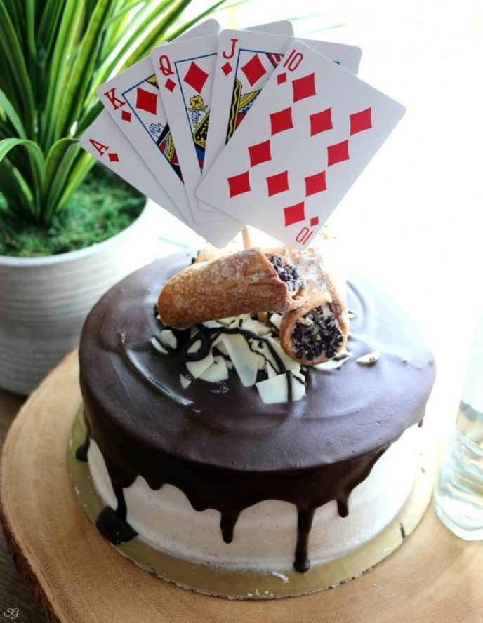 Rum cake with cannoli frosting, homemade chocolate ganache, and whole cannolis on top.