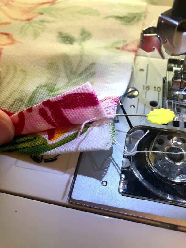 Sewing together plastic bag dispenser seams
