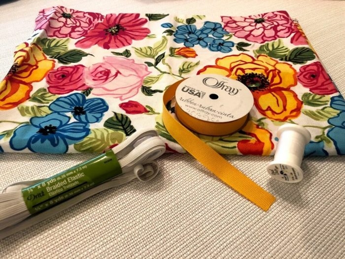 Fabric, ribbon, elastic, and thread, materials for the bag holder.