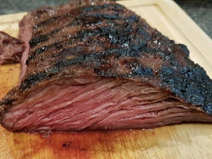 Flank steak cut to show inside after being marinated and cooked with this flank steak marinade recipe.