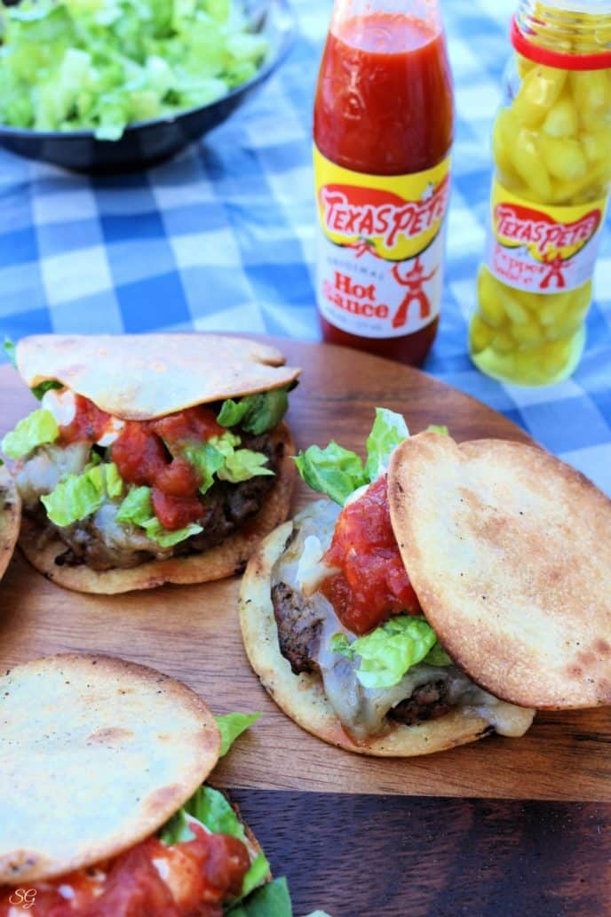 Quesadilla burgers on the grill for summer cookouts.