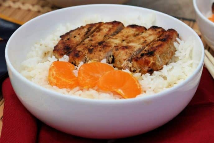 Grilled curry pork chops recipe over rice
