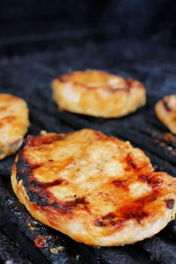 Grilling boneless pork chops with curry marinade.