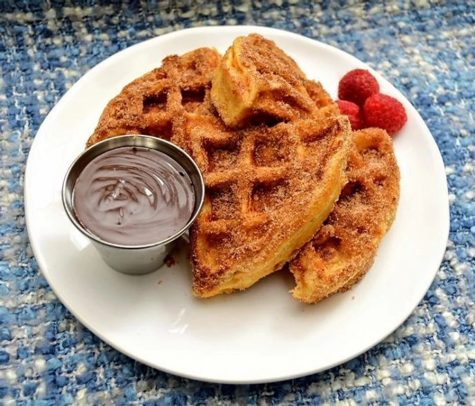 Cinnamon sugar churro style waffle topping with a side of spicy chocolate sauce