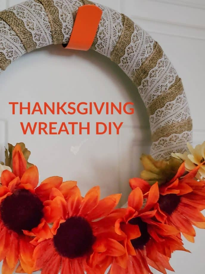 Thanksgiving wreath with burlap and festive flowers
