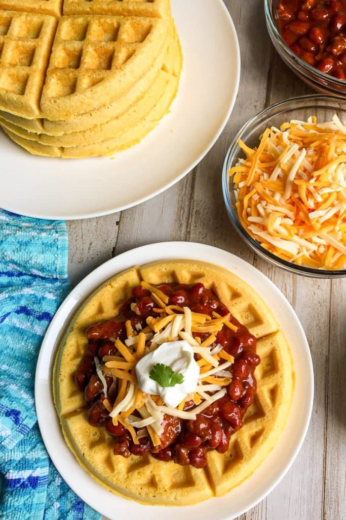Savory chili waffle topping, beautiful waffles topped with chili, cheese, and sour cream