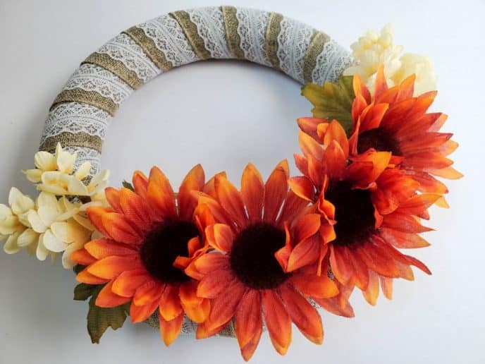 Thanksgiving wreath with burlap ribbon and orange and white flowers