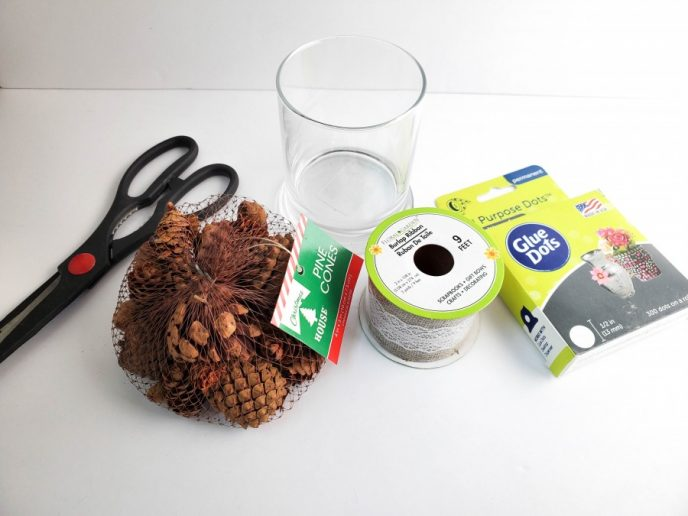 Materials to make a pine cone home decoration project.