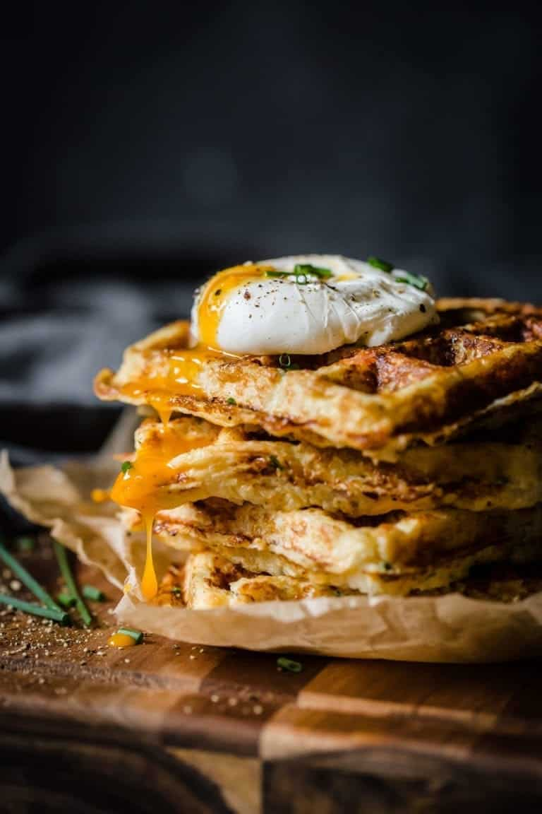 Poached egg topped waffle stack