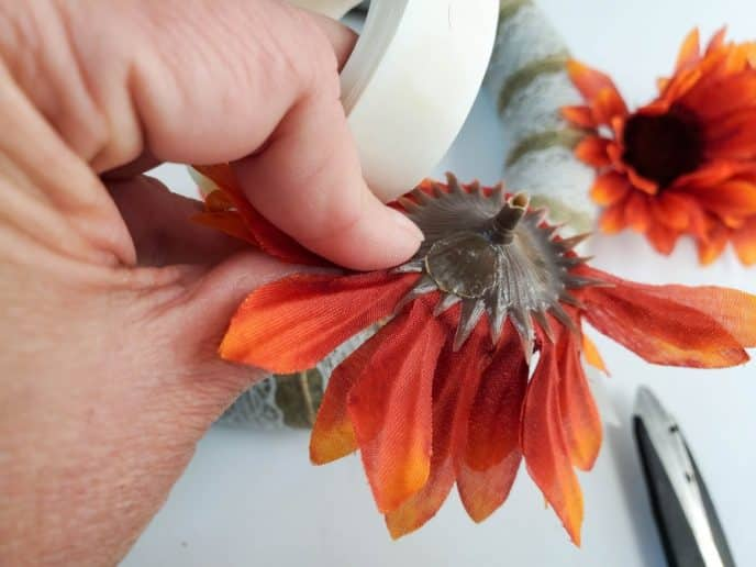Removing faux flowers from the stems