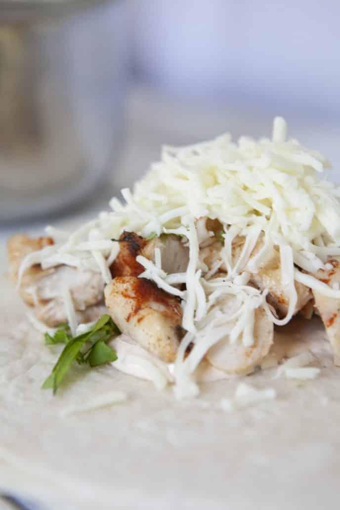 sriracha chicken wrap ingredients on flour tortillas