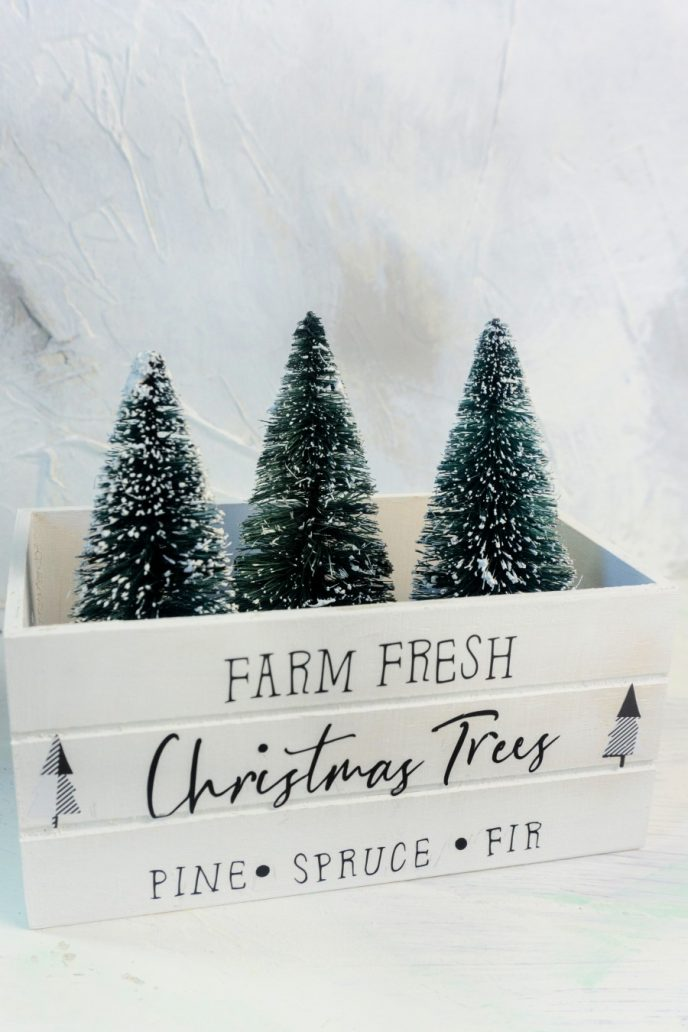 Decoration For Christmas Using Cricut, A Crate, and Mini Christmas Trees