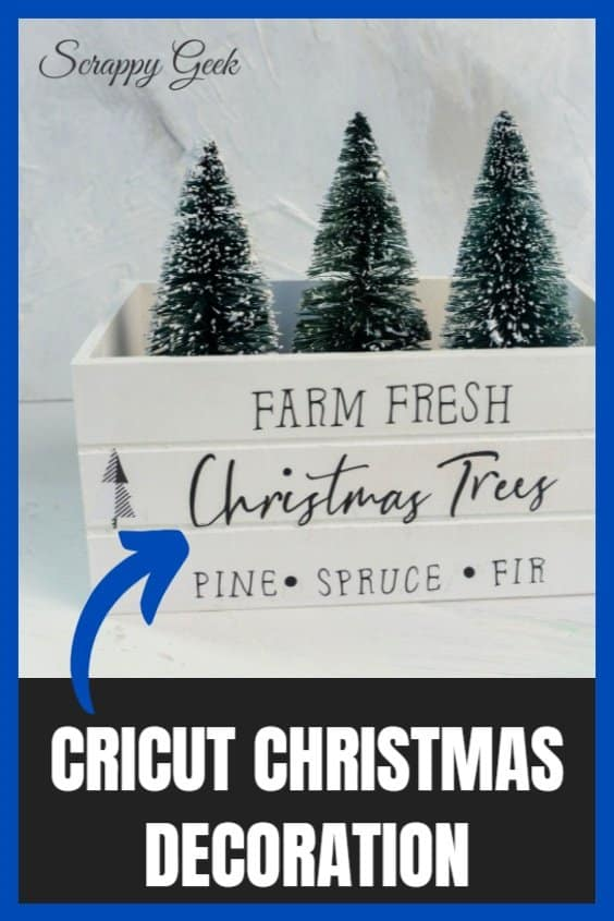 Decoration for Christmas using the Cricut cutting machine that says Farm Fresh Christmas Trees, Pine, Spruce, Fir on a white crate with mini Christmas trees peeking out the top of the crate