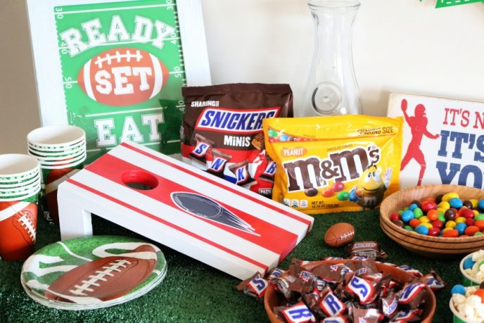 Football themed tabletop cornhole boards DIY how to placed on a table with party food