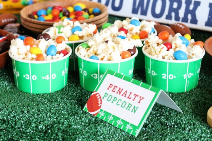 Penalty Popcorn with M&MS candies in football themed individual serving dishes.