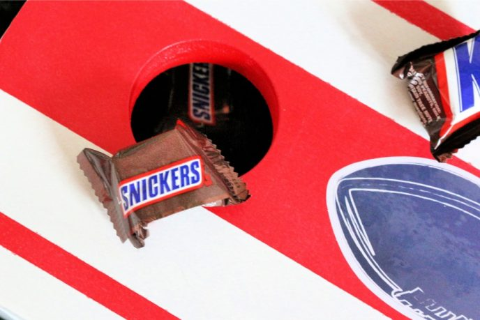 tabletop cornhole game using snickers candies for cornhole bags