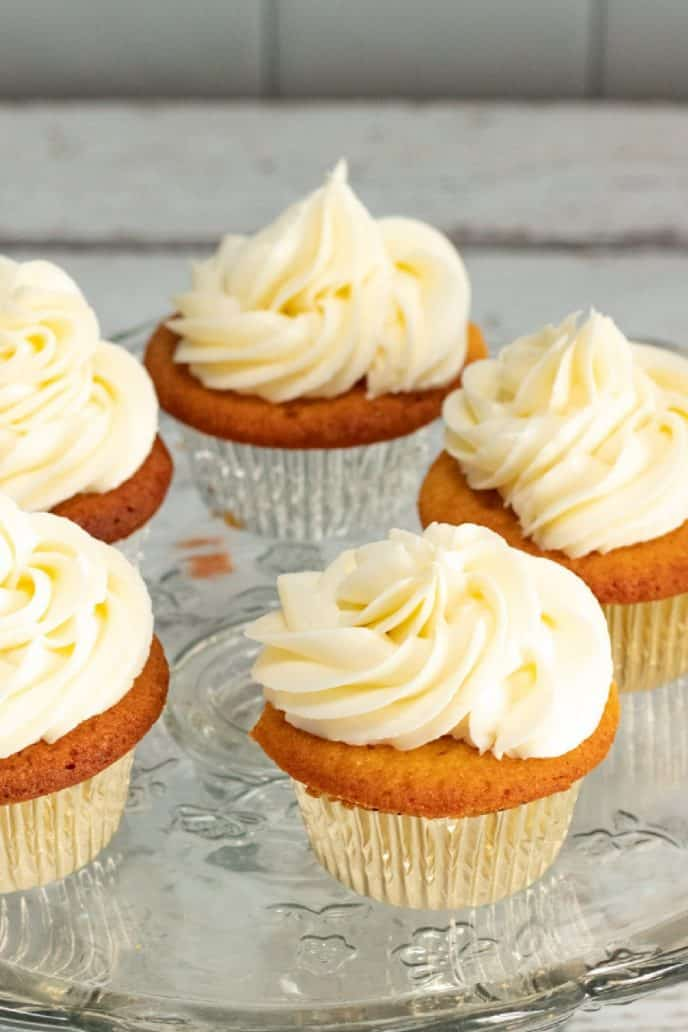 Champagne cupcakes topped with buttercream frosting