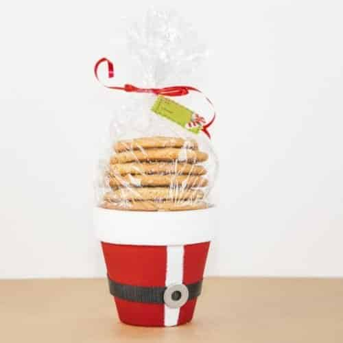 Santa cookie bucket DIY Christmas gift for neighbors; clay pot painted like Santa's jacket and filled with cookies.
