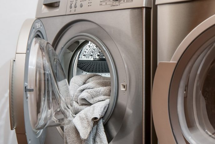 Save money on your electric bill by altering your laundry habits. Laundry washing mashing with clothes hanging out the front