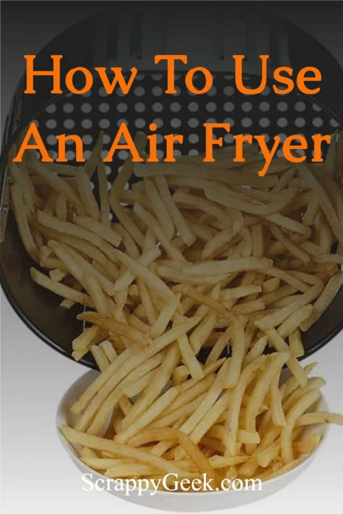How to use an air fryer. Cooked French fries in an air fryer basket being dumped into a white bowl.