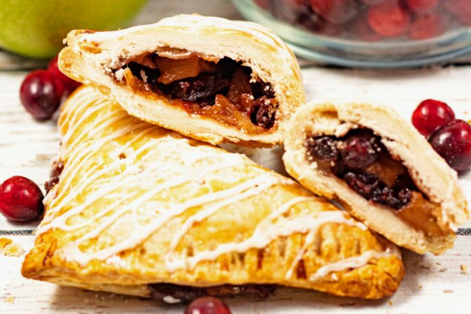 Apple turnovers with apple cranberry filling and sugar icing.