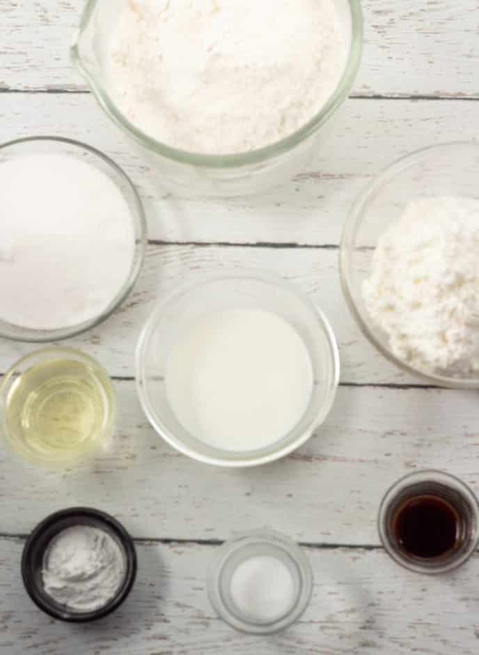Danish pastry ingredients on the table in clear bowls.