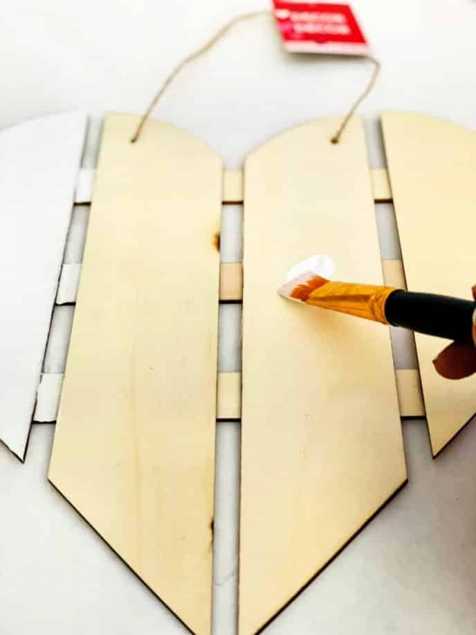 Painting Valentines Day Gift DIY Heart with white paint on every other slat