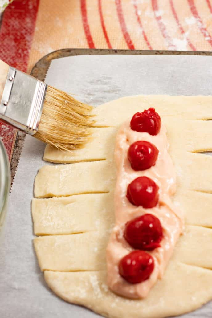 Adding cherry filling to Danish Pastry dough before baking